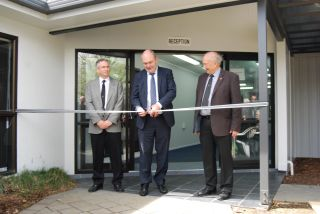 Minister cuts ribbon on new premises